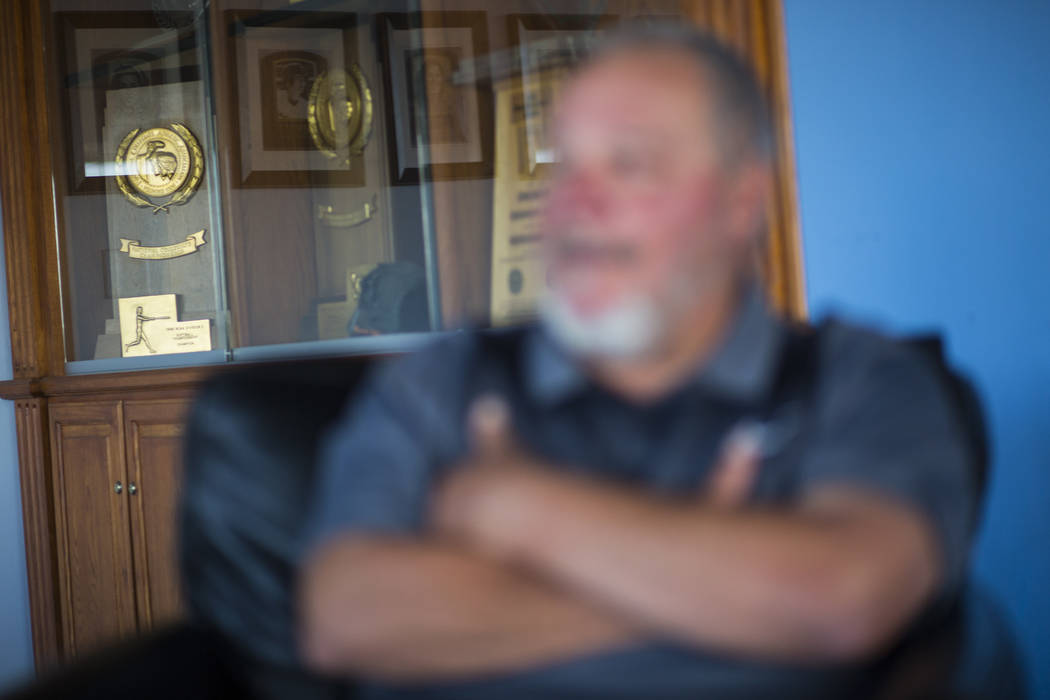 A variety of trophies, including four national championships, behind head coach Rick Vanderhook in the Cal State Fullerton baseball team clubhouse in Fullerton, Calif. on Wednesday, Oct. 31, 2018. ...