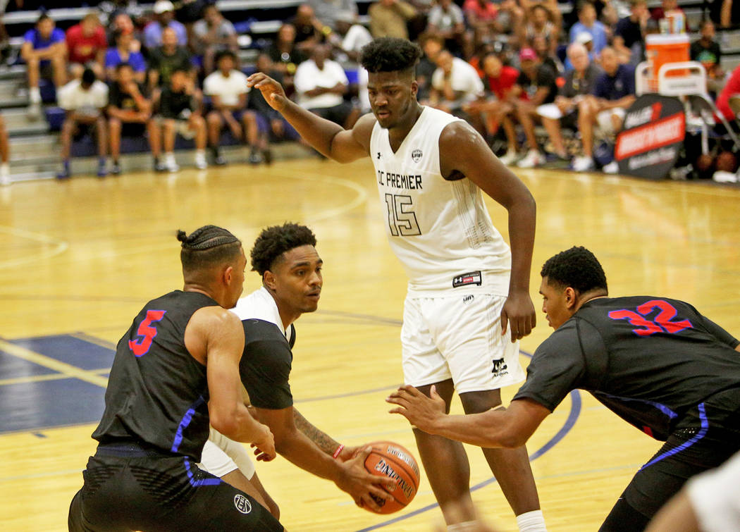 DC Premier's Sherif Kenny (1) prepares to pass The Truth's Jaden Shackleford (5) and Carl Lewis (32) at the Fab 48 tournament at Bishop Gorman High School in Las Vegas, Sunday, July 29, 2018. Rach ...