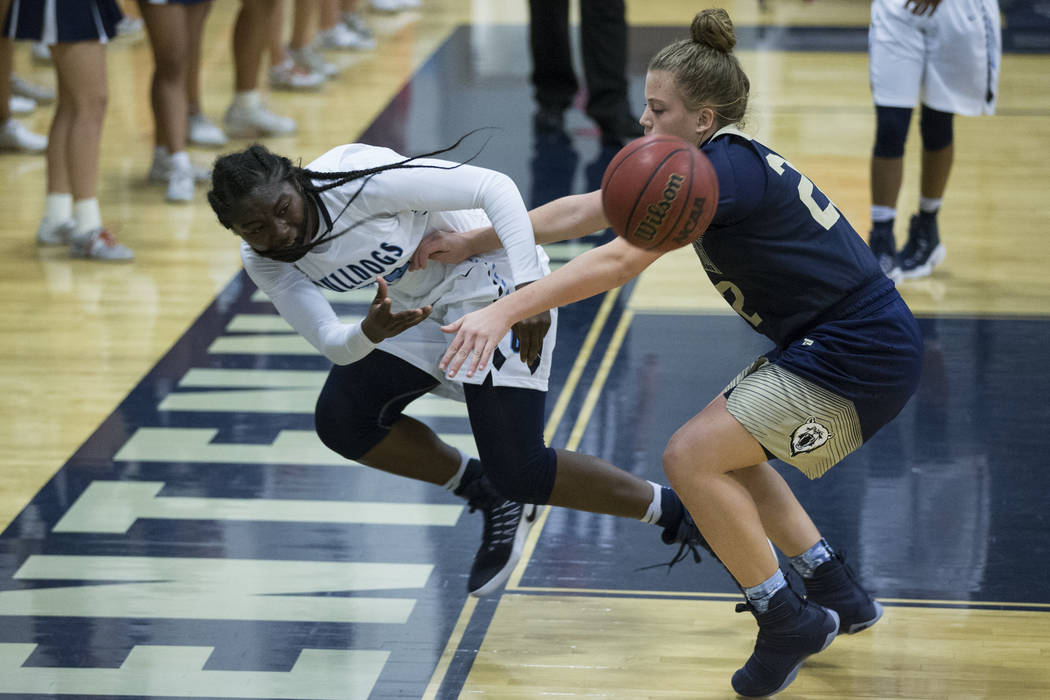 Centennial's Eboni Walker (22) saves the ball against Spring Valley in the girls basketball game at Centennial High School on Friday, Dec. 9, 2016, in Las Vegas. Centennial won 64-20. Erik Verduzc ...
