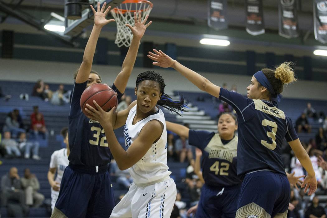 Centennial's Daejah Phillips (23) looks for an open pass against Spring Valley in the girls basketball game at Centennial High School on Friday, Dec. 9, 2016, in Las Vegas. Centennial won 64-20. E ...