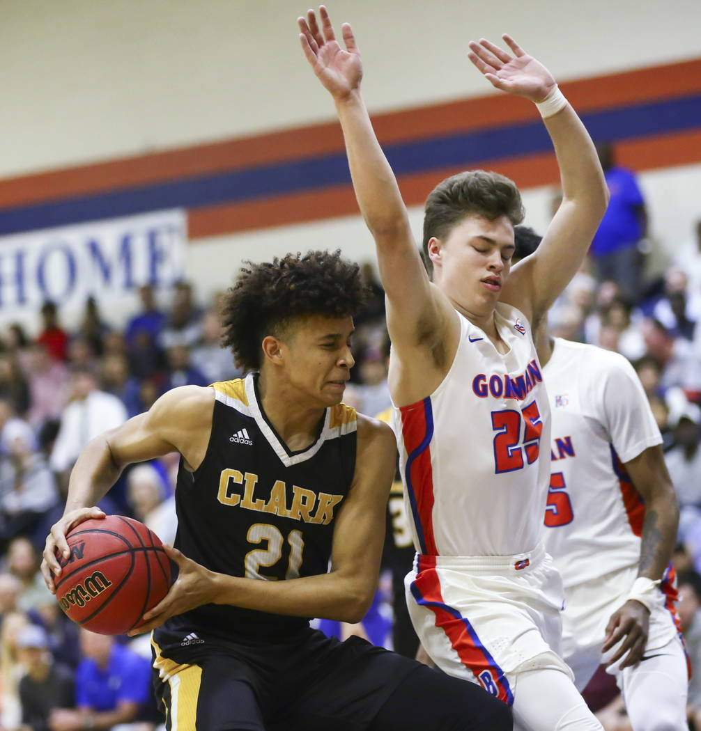 Clark's Jalen Hill (21) drives against Bishop Gorman's Chance Michels (25) during a basketball game at Bishop Gorman High School in Las Vegas on Friday, Feb. 9, 2018. Chase Stevens Las Vegas Revie ...