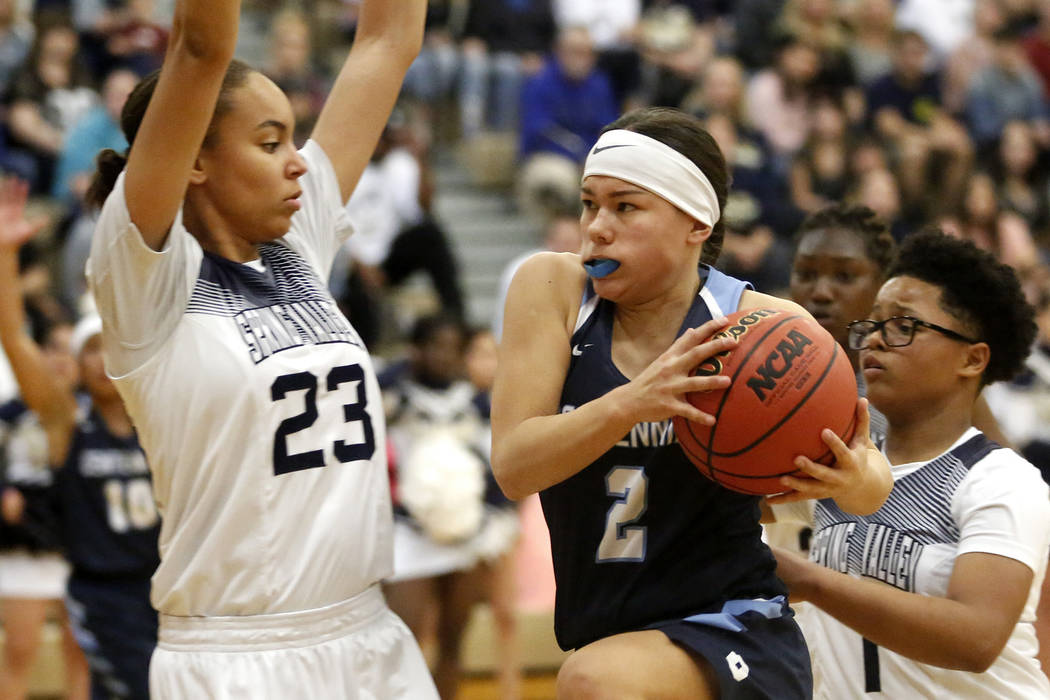 Centennial's Melanie Isbell (2) shoots against Spring Valley's Alexus Quaadman (23) during the Sunset Region girls basketball championship at Legacy High School in North Las Vegas on Saturday, Feb ...