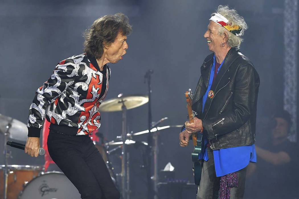 Mick Jagger, left, and Keith Richards of The Rolling Stones perform on May 18, 2018, during their No Filter tour in London. The band says it is adding a 13-show U.S. leg to its tour in spring 2019 ...