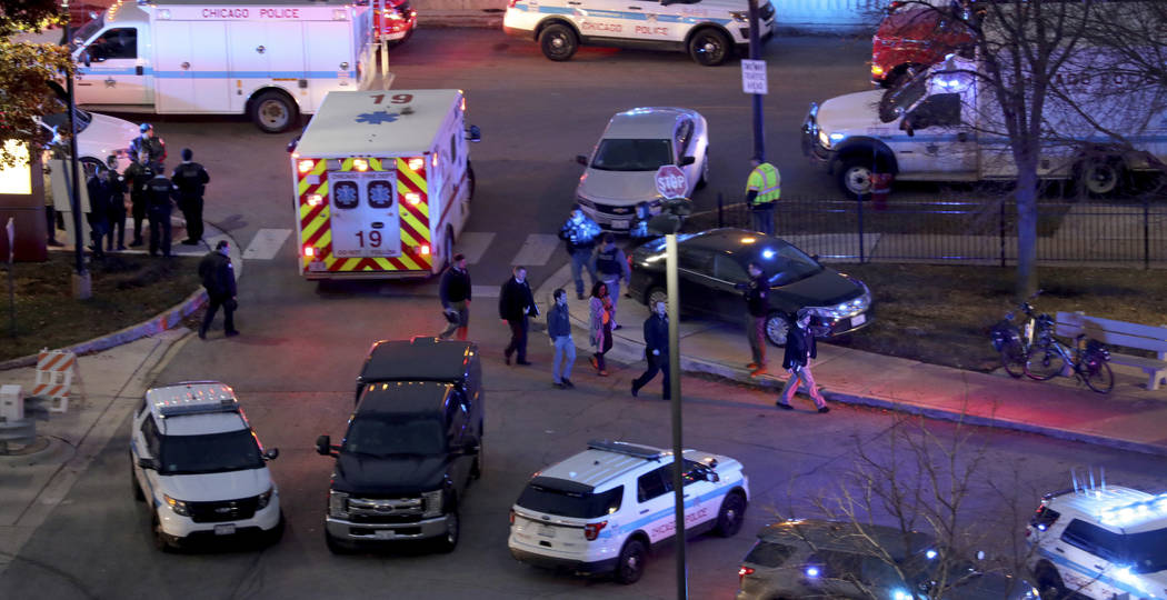 Law enforcement officials work near Mercy Hospital in Chicago, Monday, Nov. 19, 2018. A shooting at the Chicago hospital has wounded multiple people, including a suspect and a police officer, auth ...