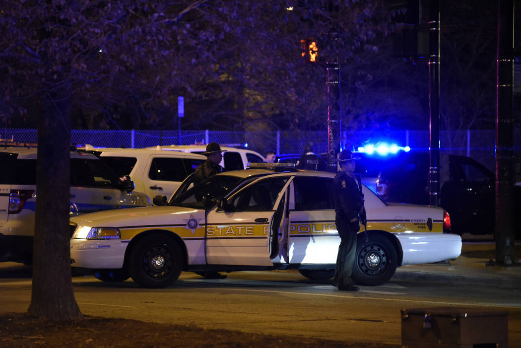 Chicago Police work the scene after a gunman opened fire at Mercy Hospital, Monday, Nov. 19, 2018, in Chicago. A police spokesman said the gunman was dead, but it was not immediately clear if he t ...