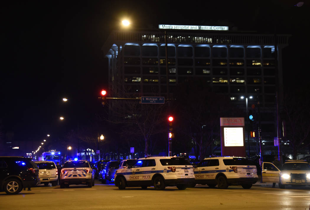Chicago Police work the scene where a gunman opened fire at Mercy Hospital, Monday, Nov. 19, 2018, in Chicago. A police spokesman said the gunman was dead, but it was not immediately clear if he t ...