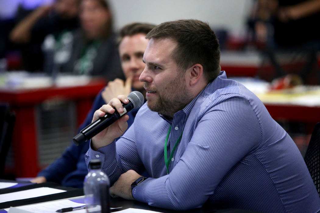 Piotr Tomasik, co-founder and CTO of Influential, asks a question of the presenter at the 2018 Techstars Startup Weekend at Rob Roy's Innevation Center in Las Vegas, Sunday, Nov. 18, 2018. With th ...