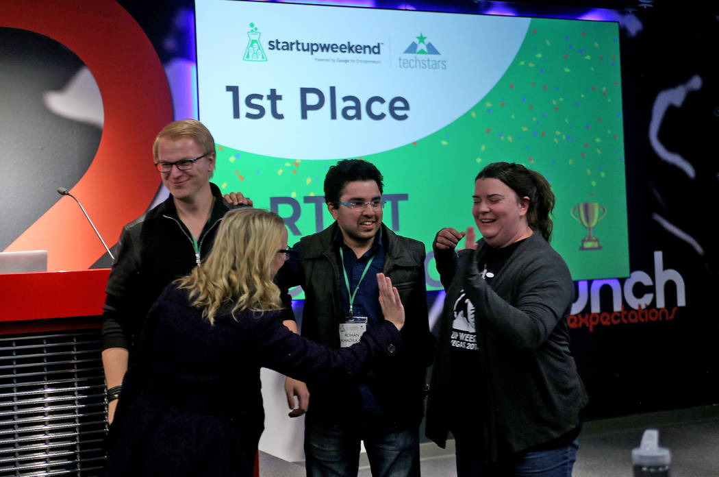 Members of the team Artist Connect celebrate after winning first place at the 2018 Techstars Startup Weekend at Rob Roy's Innevation Center in Las Vegas, Sunday, Nov. 18, 2018. With the help of en ...