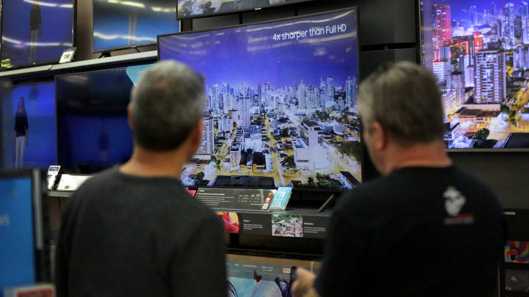 Brothers Robert, left, and Joe Seeburger check out high resolution LED TVs at Walmart on Tuesday, Nov. 20, 2018, just before the holiday shopping season begins. (Michael Quine/Las Vegas Review-Jou ...