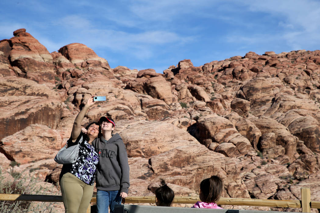 Barbara and her son Dakota, 15, of Oregon take a photo near the Calico I parking area on the Scenic Loop in Red Rock Canyon Nation Conservation Area Tuesday, Nov. 20, 2018. K.M. Cannon Las Vegas R ...