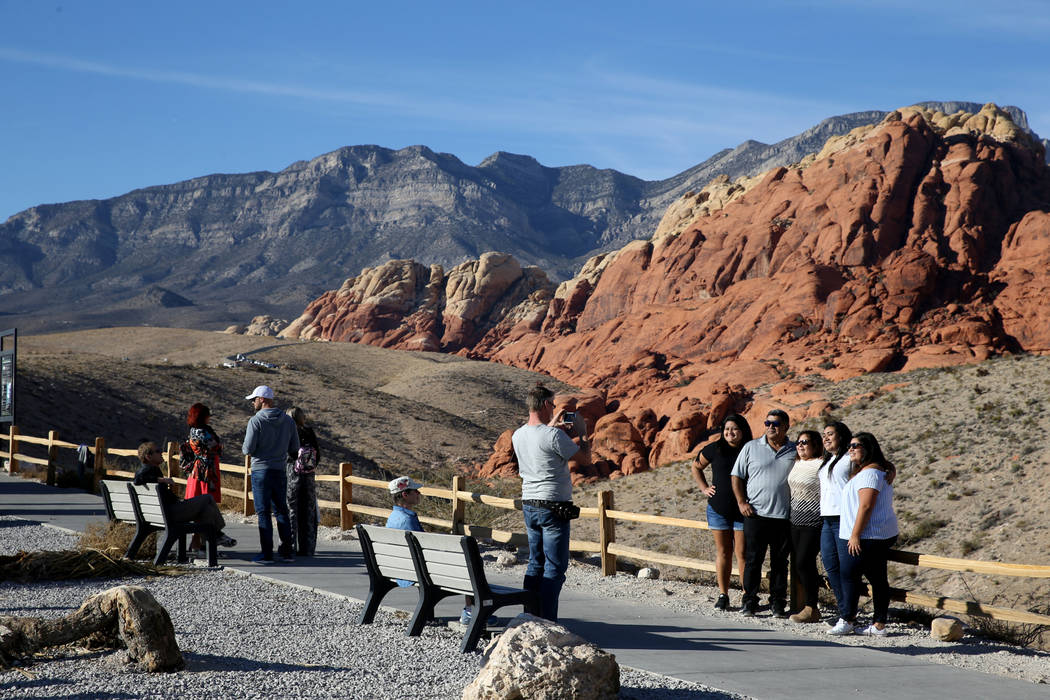 People take in the view from the Calico I parking area on the Scenic Loop in Red Rock Canyon Nation Conservation Area Tuesday, Nov. 20, 2018. K.M. Cannon Las Vegas Review-Journal @KMCannonPhoto