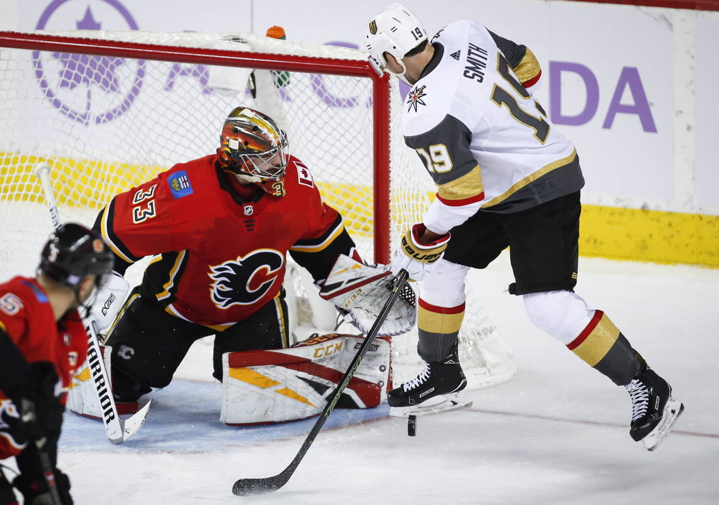 Vegas Golden Knights' Reilly Smith, right, has his shot blocked by Calgary Flames goalie David Rittich, of the Czech Republic, during third period NHL hockey action in Calgary, Alberta, Monday, No ...
