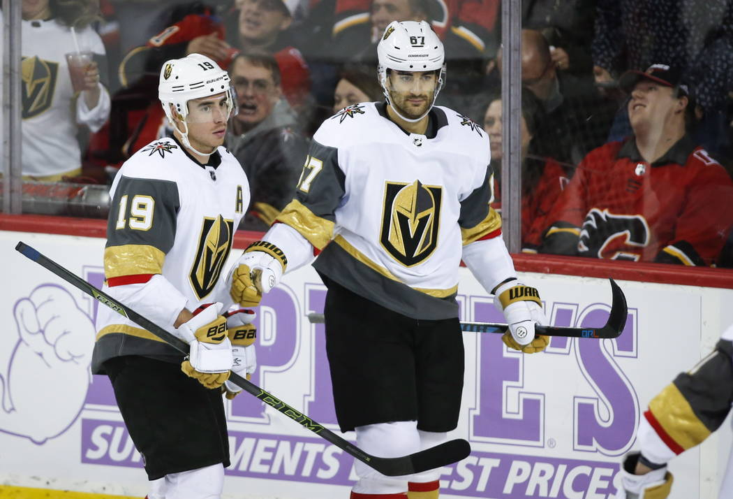 Vegas Golden Knights' Max Pacioretty, right, celebrates his goal with teammate Reilly Smith during third period NHL hockey action against the Calgary Flames in Calgary, Alberta, Monday, Nov. 19, 2 ...