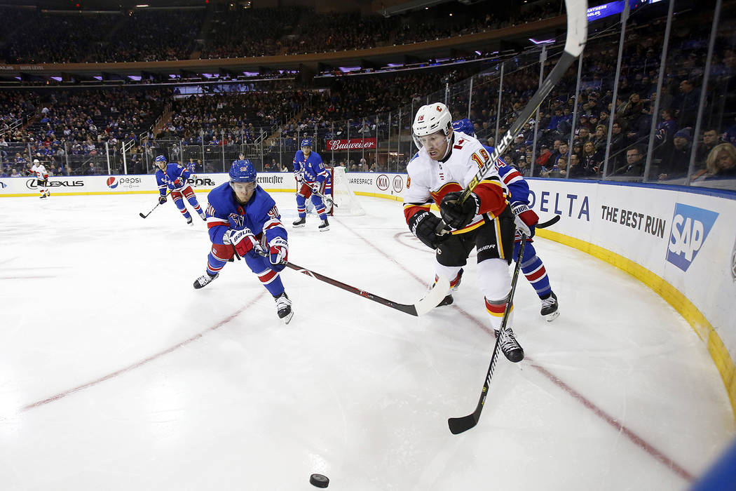 Calgary Flames left wing James Neal (18) battles for the puck with New York Rangers center Vladislav Namestnikov (90) in the first period of an NHL hockey game Sunday, Oct. 21, 2018, in New York. ...