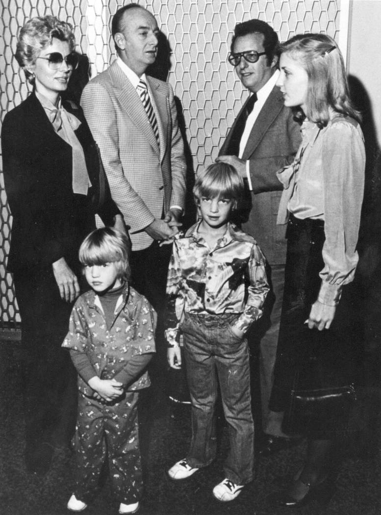 "Las Vegas casino operator Frank ""Lefty"" Rosenthal, second from left, stands with his attorney Oscar Goodman, second from right, and his family, from left, wife Geri, and kids, Stephanie, Steven an ..."