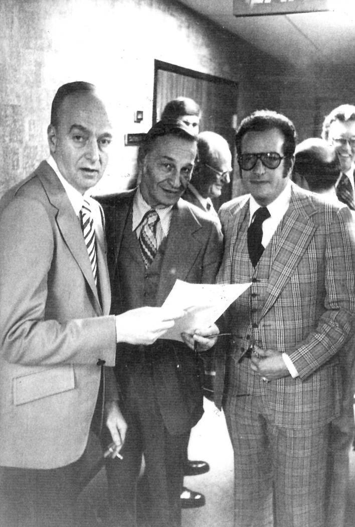 "Las Vegas casino operator Frank ""Lefty"" Rosenthal, left, looks over paperwork with attorney Harry Claiborne, center, and attorney Oscar Goodman in this undated Review-Journal file photo."