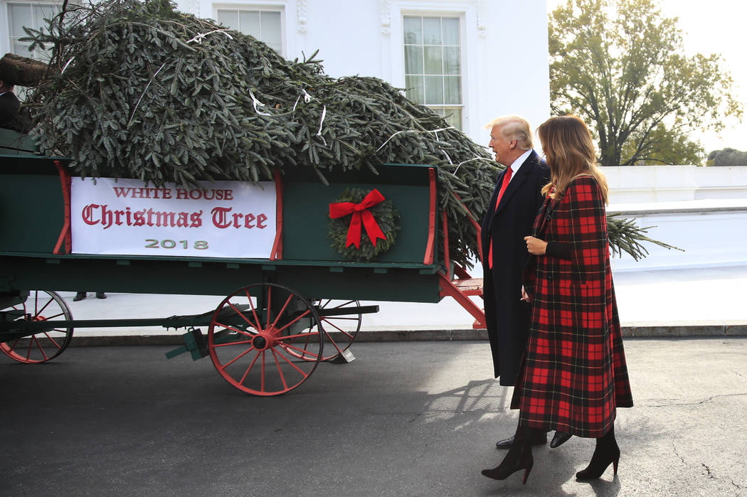 President Donald Trump and first lady Melania Trump receive the White House Christmas Tree, at the North Portico of the White House, in Washington, Monday, Nov. 19, 2018. The North Carolina-grown ...