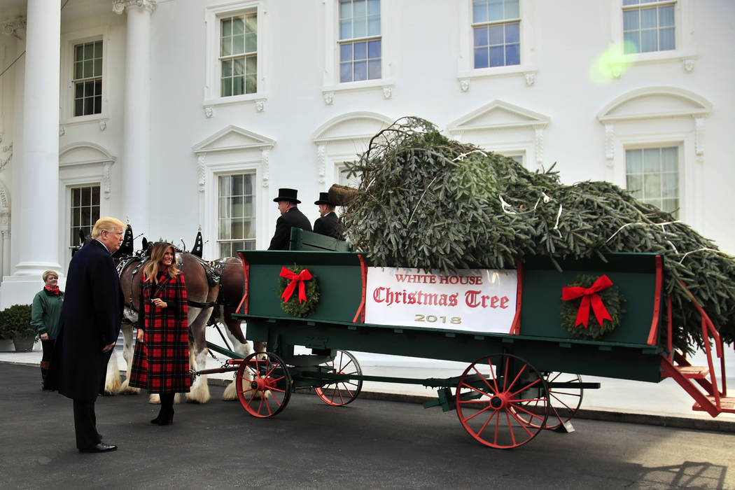 President Donald Trump and first lady Melania Trump receive the White House Christmas Tree at the North Portico of the White House, in Washington, Monday, Nov. 19, 2018. The North Carolina-grown 1 ...