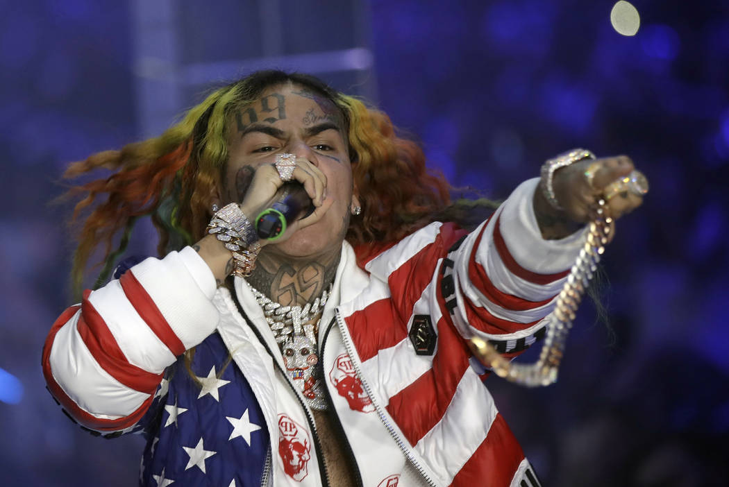 In this Sept. 21, 2018, file photo rapper Daniel Hernandez, known as Tekashi 6ix9ine, performs during the Philipp Plein women's 2019 Spring-Summer collection, unveiled during the Fashion Week in M ...