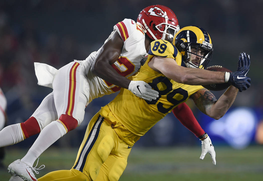 Los Angeles Rams tight end Tyler Higbee (89) catches a pass in front of Kansas City Chiefs strong safety Eric Murray, left, during the first half of an NFL football game Monday, Nov. 19, 2018, in ...