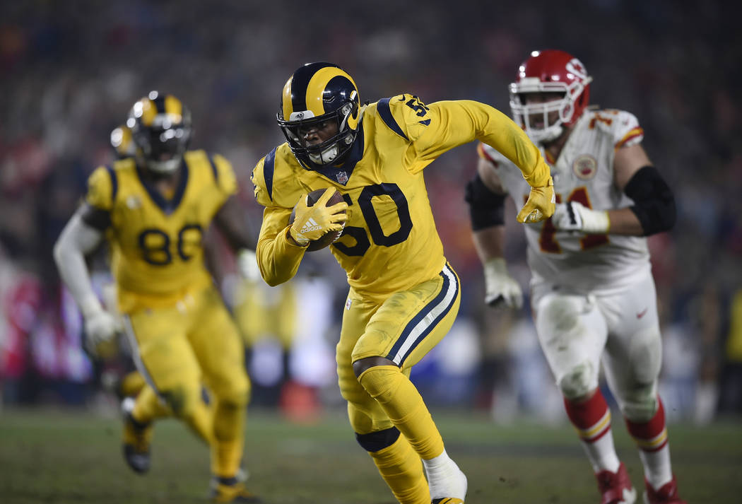 Los Angeles Rams outside linebacker Samson Ebukam runs for a touchdown after making an interception during the second half of an NFL football game against the Kansas City Chiefs, Monday, Nov. 19, ...