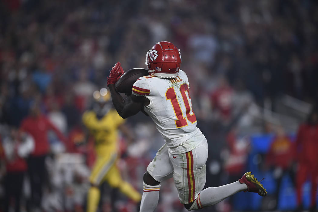 Kansas City Chiefs wide receiver Tyreek Hill hauls in a touchdown catch against the Los Angeles Rams during the second half of an NFL football game, Monday, Nov. 19, 2018, in Los Angeles. (AP Phot ...
