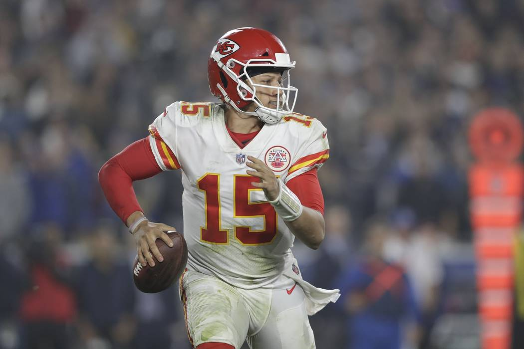 Kansas City Chiefs quarterback Patrick Mahomes (15) scrambles on a keeper play against the Los Angeles Rams during the second half of an NFL football game, Monday, Nov. 19, 2018, in Los Angeles. ( ...