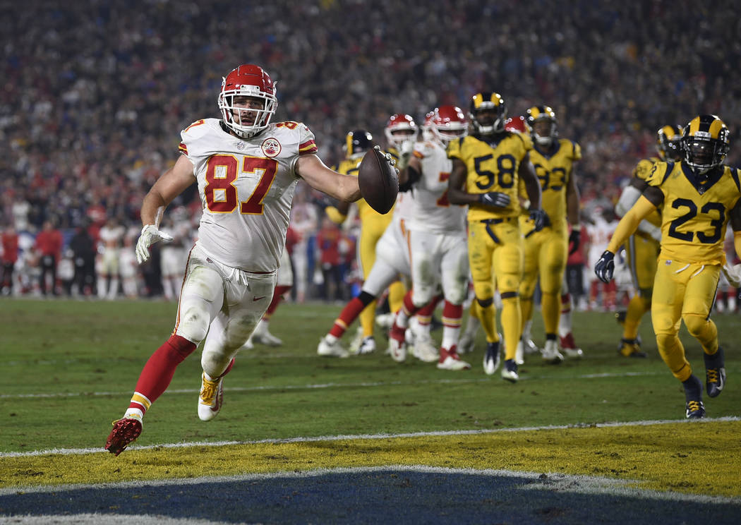Kansas City Chiefs tight end Travis Kelce (87) scores a touchdown against the Los Angeles Rams during the second half of an NFL football game, Monday, Nov. 19, 2018, in Los Angeles. (AP Photo/Kelv ...