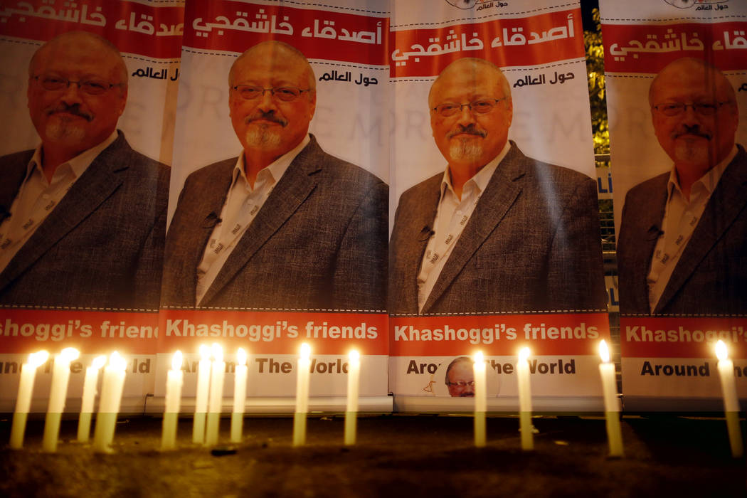Candles, lit by activists, protesting the killing of Saudi journalist Jamal Khashoggi, are placed outside Saudi Arabia's consulate, in Istanbul, during a candlelight vigil, Oct. 25, 2018. (Lefteri ...