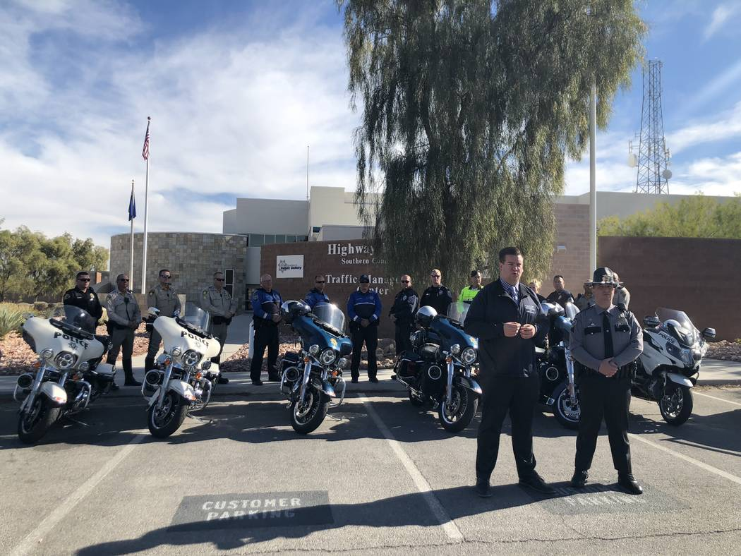 Nevada Office of Traffic Safety spokesman Andrew Bennett and Nevada Highway Patrol trooper Jason Buratczuk brief the media at the Highway Patrol's southern command to kick off the state's latest C ...