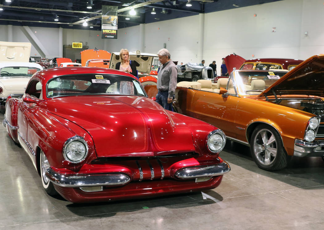 Rudy Vasquez and his wife Annett check out a 1949 Cadillac Custom-Coup during the Mecum Car Auction at the Las Vegas Convention Center on Friday, Nov. 16, 2018, in Las Vegas. Bizuayehu Tesfaye/Las ...