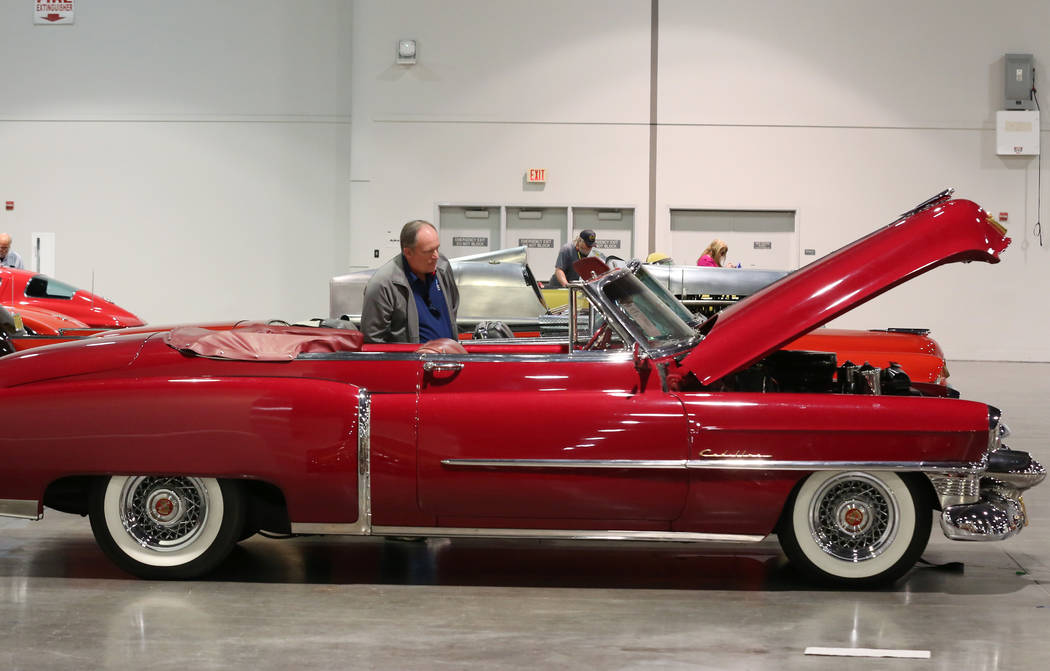 Joe Haduch checks out a 1953 Cadillac Series 62 Convertible during the Mecum Car Auction at the Las Vegas Convention Center on Friday, Nov. 16, 2018, in Las Vegas. Bizuayehu Tesfaye/Las Vegas Revi ...
