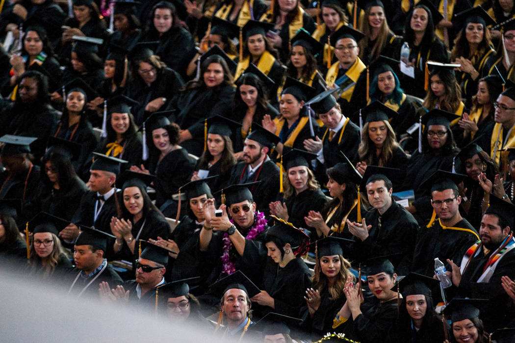 Graduates Clap And Cheer At Nevada State Colleges Commencement Ceremony In This File P O Patrick