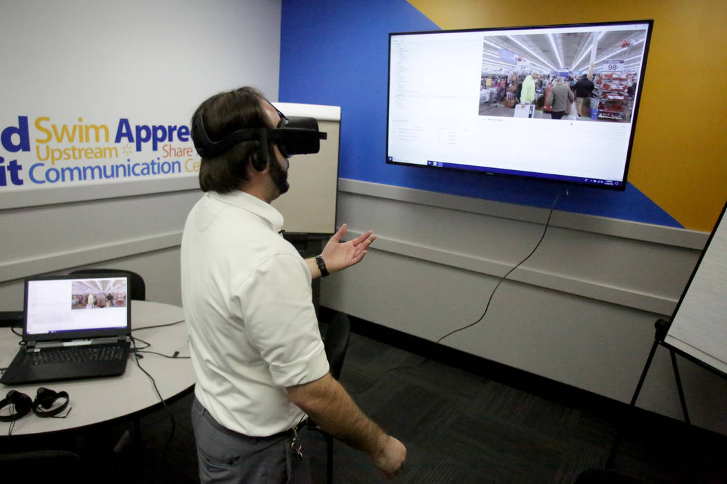 Walmart Academy Facilitator Vincent Laubach demonstrates the VR training program being used by Walmart stores across the country on Tuesday, November 20, 2018. Michael Quine/Las Vegas Review-Journ ...