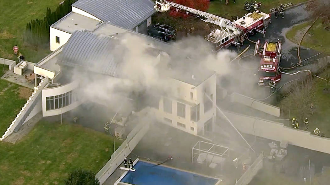 In this image made from a video, firefighters battle a fatal fire on Tuesday, Nov. 20, 2018, in Colts Neck, N.J. The Monmouth County prosecutor's office said two adults and two children died in th ...