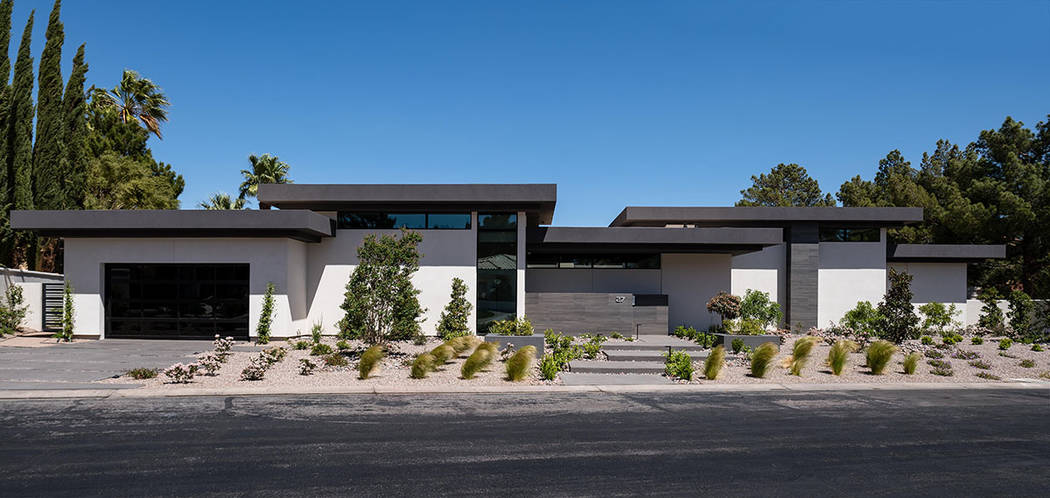 The LEED single-story home measures 8,120 feet and was built on two lots. (Studio g Architecture)
