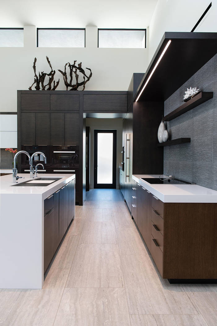 The kitchen has a modern design with clean lines. (Studio g Architecture)
