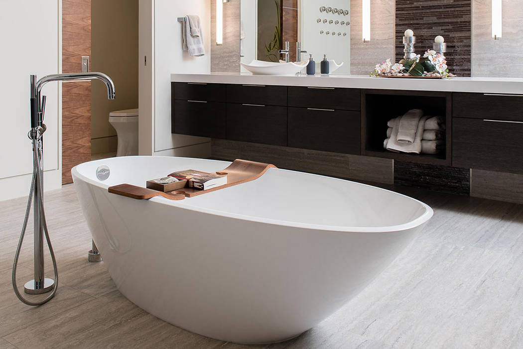 The master bath is anchored with a large soaking tub. (Studio g Architecture)