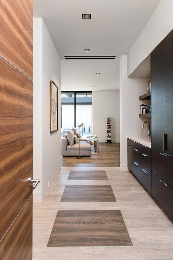 A hallway leads to the master bedroom. (Studio g Architecture)