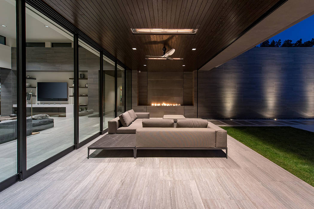 The patio has a fire feature. (Studio g Architecture)