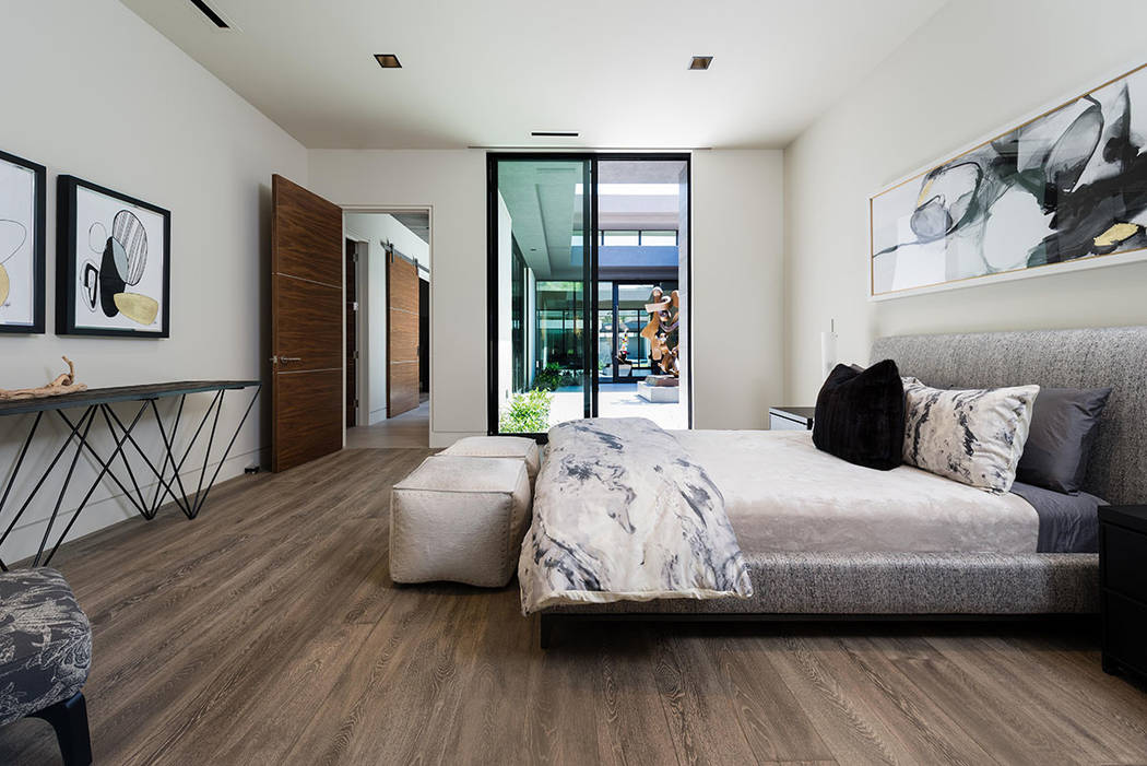 A secondary bedroom is near the courtyard. (Studio g Architecture)