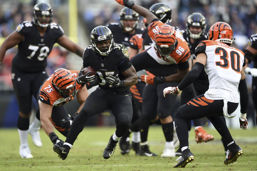 Baltimore Ravens running back Gus Edwards (35) rushes the ball in the second half of an NFL football game against the Cincinnati Bengals, Sunday, Nov. 18, 2018, in Baltimore. (AP Photo/Gail Burton)