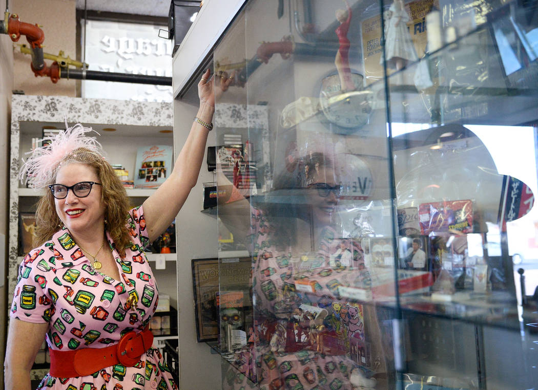 Co-owner Sarah Collins checks the lightbulb inside a display case inside Main Street Peddler Antique Mall in Las Vegas, Wednesday, Nov. 21, 2018. Caroline Brehman/Las Vegas Review-Journal