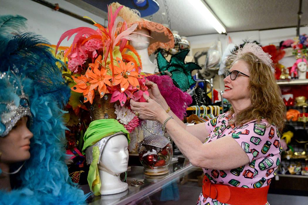 Co-owner Sarah Collins spruces up a costume display inside Main Street Peddler Antique Mall in Las Vegas, Wednesday, Nov. 21, 2018. Caroline Brehman/Las Vegas Review-Journal
