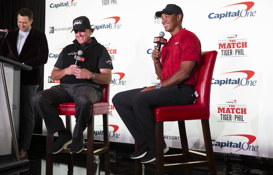 Phil Mickelson, second left, and Tiger Woods take questions during a press conference at Shadow Creek Golf Course in North Las Vegas on Tuesday, Nov. 20, 2018. The golfers will compete in a match ...