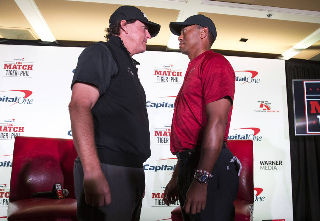 Phil Mickelson and Tiger Woods face off during a press conference at Shadow Creek Golf Course in North Las Vegas on Tuesday, Nov. 20, 2018. The golfers will compete in a match play event on Friday ...