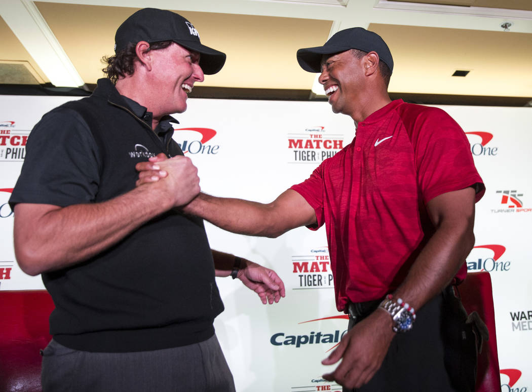 Phil Mickelson and Tiger Woods share a laugh after facing off during a press conference at Shadow Creek Golf Course in North Las Vegas on Tuesday, Nov. 20, 2018. The golfers will compete in a matc ...