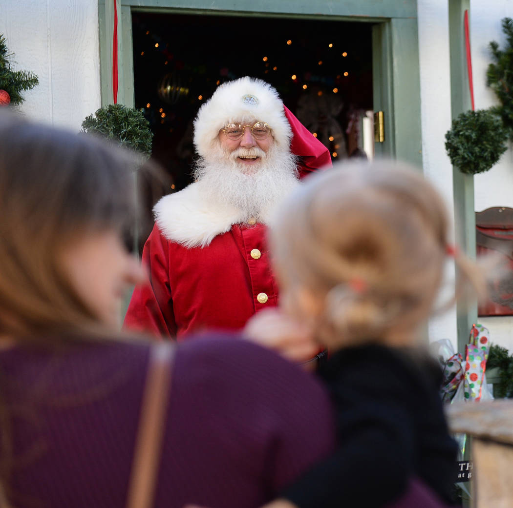 Santa Claus greets Henderson residents Monica Brodie and Emilia Brodie, 2, at the District at Green Valley Ranch in Henderson, Saturday, Nov. 24, 2018. Caroline Brehman/Las Vegas Review-Journal