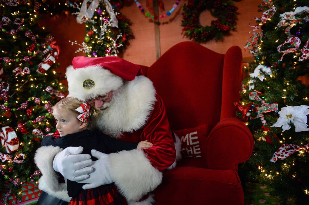 Emilia Brodie, 2, gives Santa Claus a hug at the District at Green Valley Ranch in Henderson, Saturday, Nov. 24, 2018. Caroline Brehman/Las Vegas Review-Journal