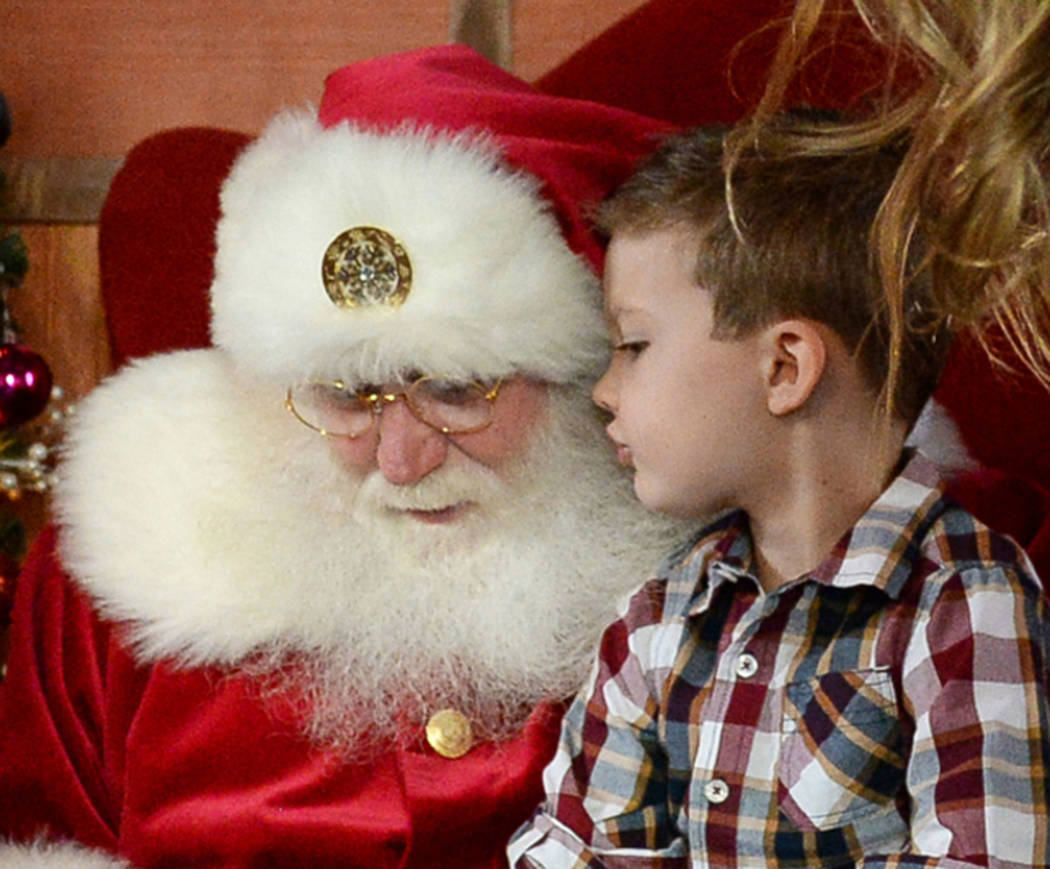 Maverick Willis, 5, from Henderson, sits on Santa Claus' lap at the District at Green Valley Ranch in Henderson, Saturday, Nov. 24, 2018. Caroline Brehman/Las Vegas Review-Journal